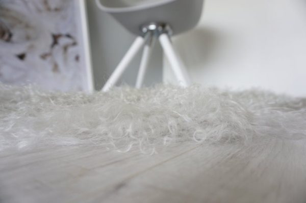 Muffin and Poppy sheepskin cat beds